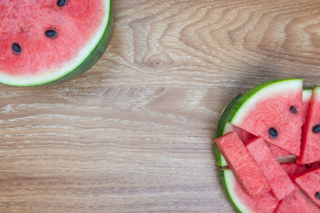 Fresh watermelon on wooden background. sweet summer fruit.