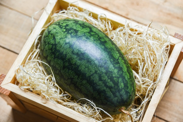 Fresh watermelon on wooden box top view