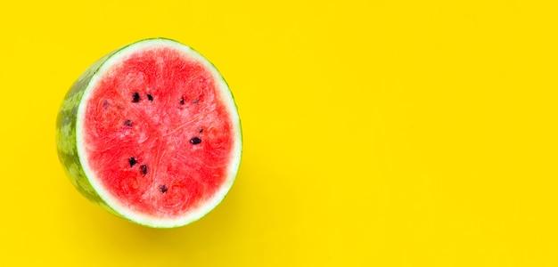 Fresh watermelon on yellow background.