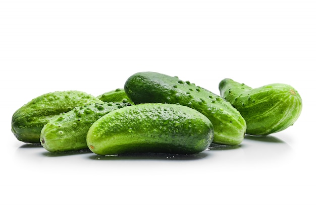 Fresh wet cucumbers isolated on white