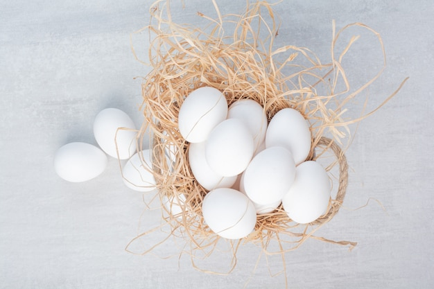 Fresh white eggs on marble background.