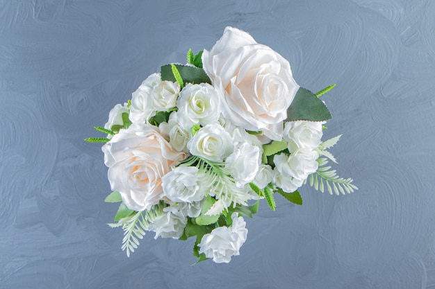 Fresh white flowers in a vase, on the marble table.
