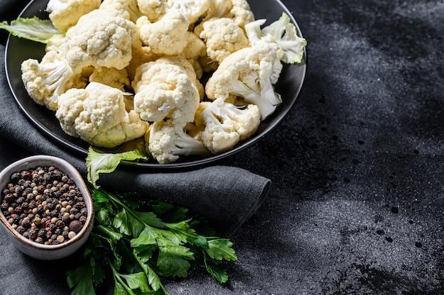 Fresh white heads cleaned cauliflower in a bowl