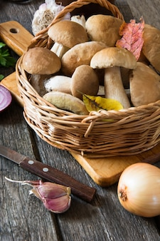 Fresh white mushrooms from  forest in basket for cooking.