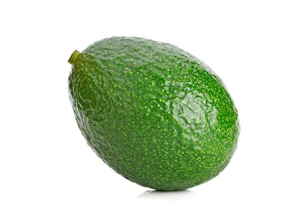 Fresh whole avocado isolated on white background