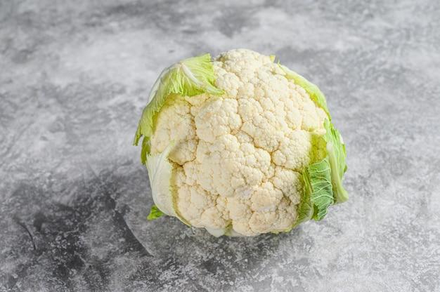 Fresh whole organic cauliflower with leaves