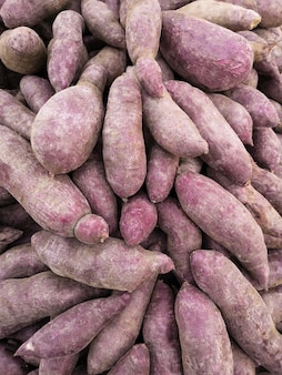 Fresh yams for sale on the market. soft focus.
