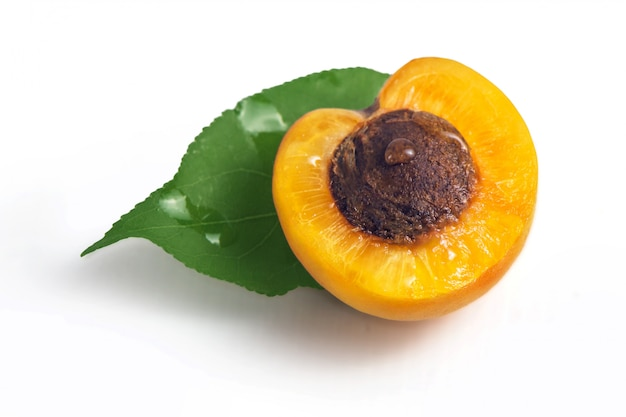 Fresh yellow apricots with green leaf
