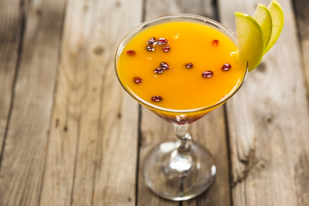 Fresh yellow cocktail in martini glass