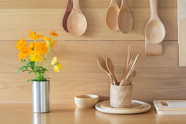 Fresh yellow flowers in the vase and kitchen