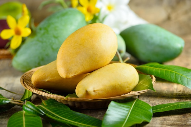 Fresh yellow and green mango on wooden table