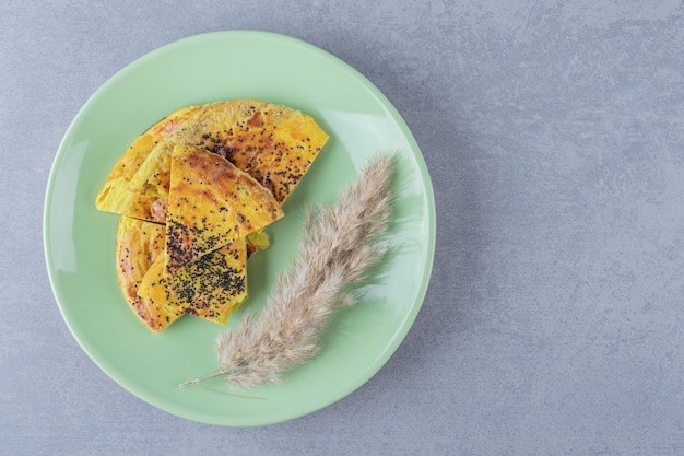 Fresh yellow homemade cookie on green plate