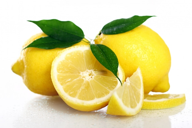 Fresh yellow lemons on white
