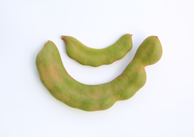 Fresh young green tamarind (tamarindus indica) isolated on white background.