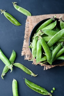 Fresh, young, unpeeled green peas