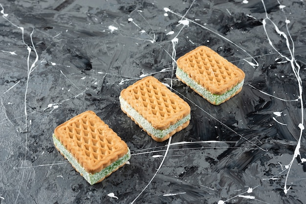 Freshly baked belgian waffles isolated on a marble surface