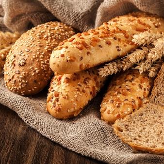 Freshly baked bread assortment on wooden board