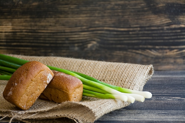 Freshly baked bread and green onion