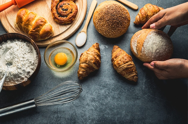 Freshly baked bread on wooden table, bakery concept, top view flat lay
