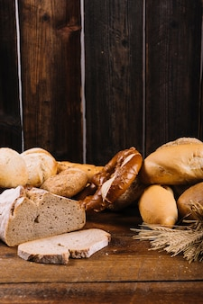Freshly baked bread on wooden textured background
