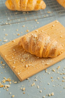 Freshly baked croissants on black plate. french and american croissants and baked pastries are enjoyed world wide.