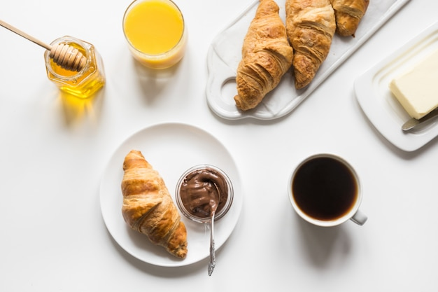 Freshly baked croissants and cup of coffee. french breakfast.