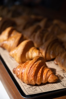 Freshly baked croissants, golden brown on paper, ready to serve in the morning.