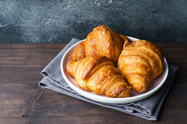 Freshly baked croissants on a plate