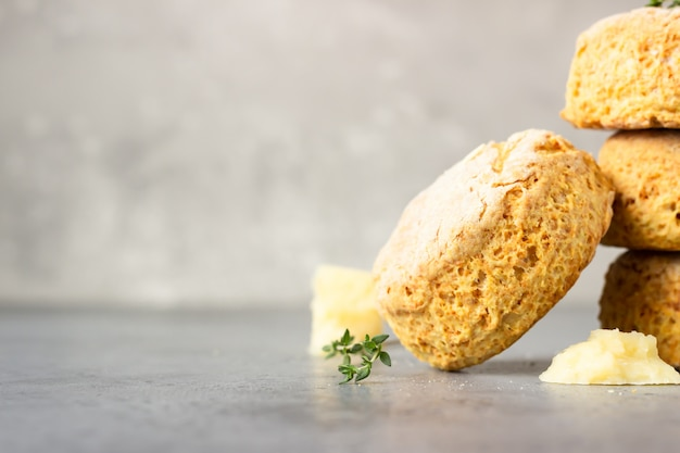 Freshly baked delicious homemade english scones with cheese and thyme