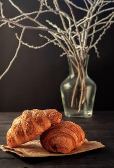 Freshly baked homemade crispy croissants on a black table
