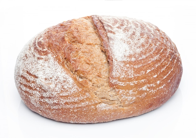 Freshly baked  loaf of bread with flour