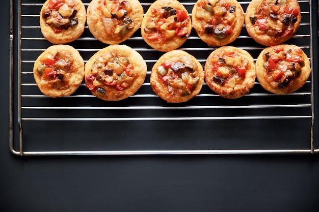 Freshly baked mini pizzas сocas