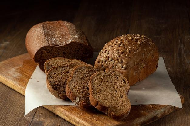 Freshly baked sliced rye bread on a wooden cutting board