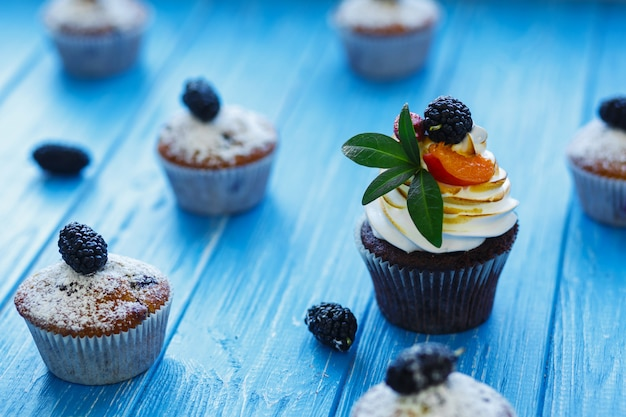 Freshly baked sweet muffins on blue. sweet pastries, recipes, cooking