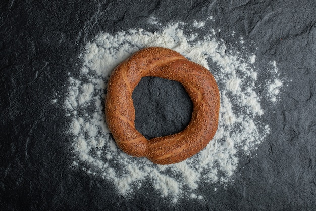 Freshly baked turkish simit on black background.