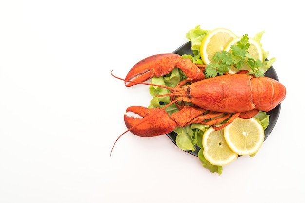 Freshly boiled lobster with vegetable and lemon isolated on white surface