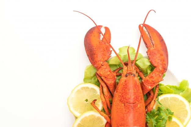 Freshly boiled lobster with vegetable and lemon