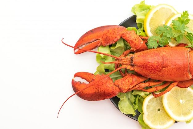 Freshly boiled lobster with vegetable and lemon
