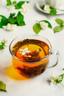 Freshly brewed green tea in glass mug