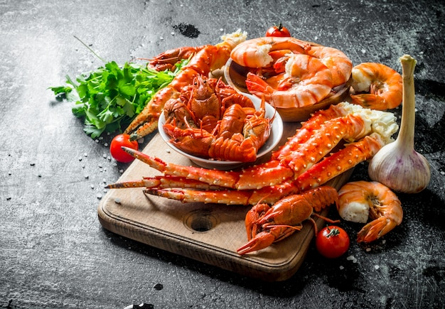 Freshly cooked crayfish, crab and shrimp with herbs.