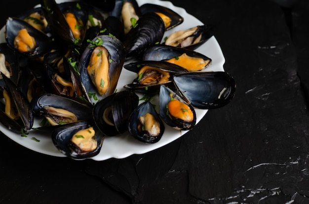 Freshly cooked mussels with parsley. healthy food concept.