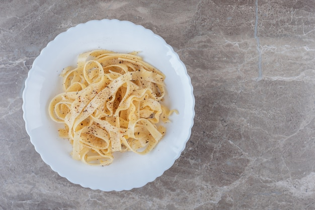 Freshly cooked spicy tagliatelle , on the marble.