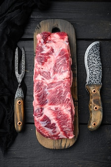 Freshly cut boneless ribeye big piece cut set, on black wooden table