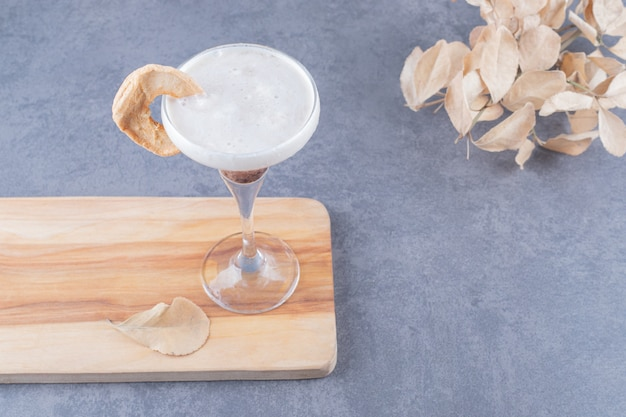 Freshly made cocktail on wooden board