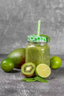 Freshly made green fruits and vegetables smoothie