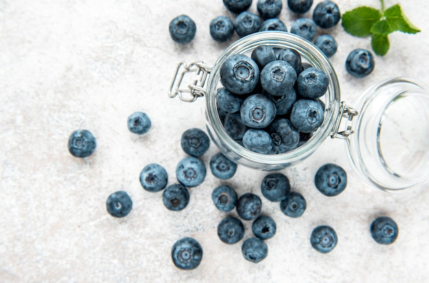 Freshly picked blueberries on a concrete background. concept for healthy eating