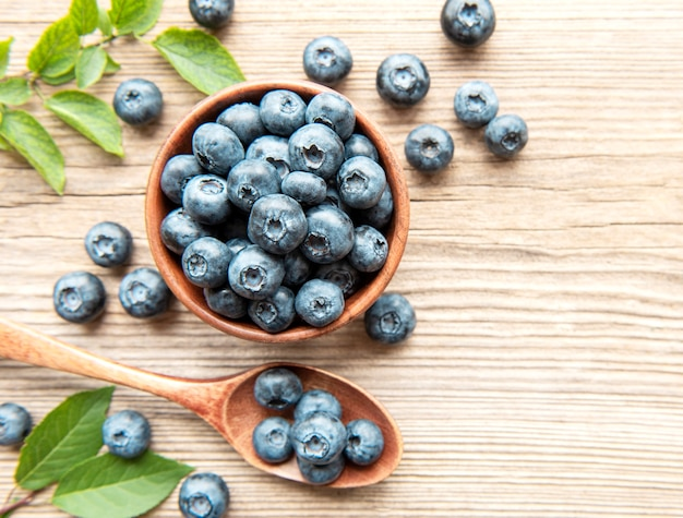 Freshly picked blueberries on a old wooden background. concept for healthy eating