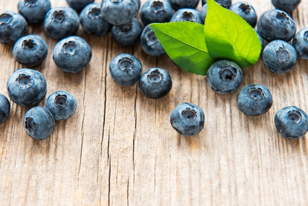 Freshly picked blueberries on a rustic wooden table. concept for healthy eating