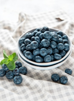 Freshly picked blueberries on a textile  background. concept for healthy eating