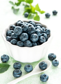 Freshly picked blueberries on a wooden background. concept for healthy eating